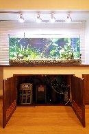 AFTER:ご主人の趣味の、水草&熱帯魚。大きな水槽の下には、給排水とろ過装置を完備。